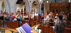 Boyce and Stanley joined by a choir during a recording for Radio 4.